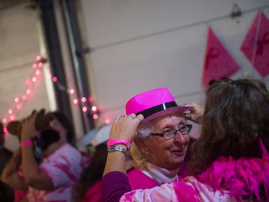Doris Krichten, of New Oxford, gets ready for a photo booth Saturday Oct. 3, 2015 during the Pink Houses Festival at the New Oxford Social Pavilion in New Oxford. The music festival helped to benefit the Pink Journey of Lights, a local organization dedicated to breast cancer fundraising and awareness. (Shane Dunlap -- The Evening Sun)
