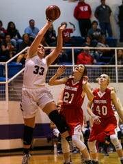 Irion County's Hadley Miller looks up to shoot as Christoval's