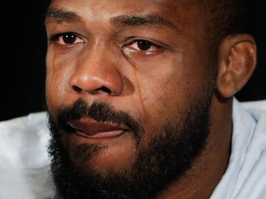 Jon Jones cries as he speaks during a July 7 news conference