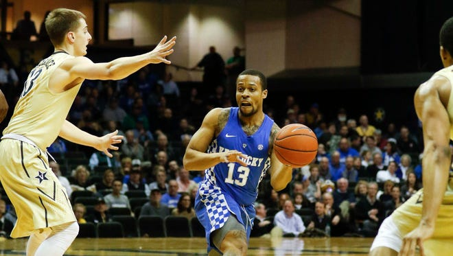 Jan 10, 2017; Nashville, TN, USA; Kentucky Wildcats guard Isaiah Briscoe (13) passes the ball against Vanderbilt Commodores guard Riley LaChance (13) in the first half at Memorial Gymnasium. Mandatory Credit: Mark Zerof-USA TODAY Sports