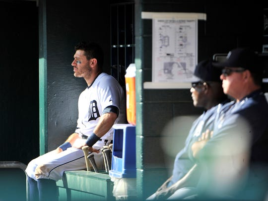 Tigers' Ian Kinsler sits in the dugout in the eighth inning.