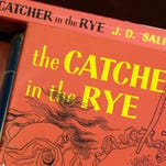 "This Jan. 28, 2010, file photo shows copies of J.D. Salinger's classic novel, ""The Catcher in the Rye."""