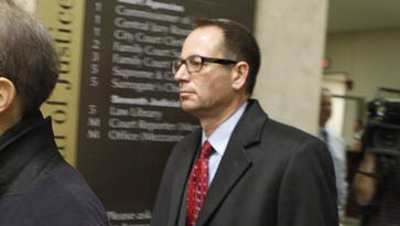 Defendant John Maggio, center, leaves court following a hearing in the LDC corruption case in Monroe County Court on Dec. 18, 2013.