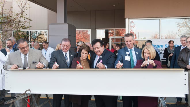From left, Vineland Mayor Anthony Fanucci, Inspira Hospital Board Chairman Gary Galloway, Inspira Foundation Cumberland/Salem Board Chair Penny Sager-Rossi, Inspira CEO John DiAngelo, Inspira Executive Vice President of Operations Todd Way and Inspira Vineland Elmer COO Elizabeth Sheridan, sign a steel beam during a ceremony for a new patient tower coming to Inspira Medical Center Vineland.