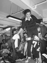 Oakland Raiders coach Tom Flores is boosted into the
