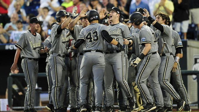 Vanderbilt's Zander Wiel (43) is congratulated by teammates including Kyle Smith (39) after his solo home run during the seventh inning Tuesday.