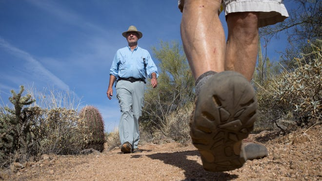 Bill Craig (left) and Steve Fleming hike a trail that will soon link preserves in Fountain Hills and Scottsdale. The cities will consider a proposal to name the trail after two preserve advocates, one of whom died earlier this month.