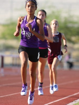 Shadow Hills High School freshman Nyah Chavez finishes a lap on her way to winning the girls 1600 with a time of 5:18.88 during the De Anza League track and field finals held Thursday, May 5, 2016, at Rancho Mirage High School.