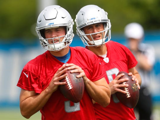 Lions quarterback Matthew Stafford, left, and Matt Cassel, right, drop back to throw during practice Tuesday, June 5.