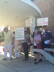 Gun owners and activists demonstrate outside Palm Springs City Hall Wednesday to protest the council's discussion of potentially tightening gun control ordinances.