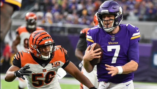 Minnesota Vikings quarterback Case Keenum (7) runs from Cincinnati Bengals linebacker Hardy Nickerson (56) during the first half of an NFL football game, Sunday, Dec. 17, 2017, in Minneapolis.