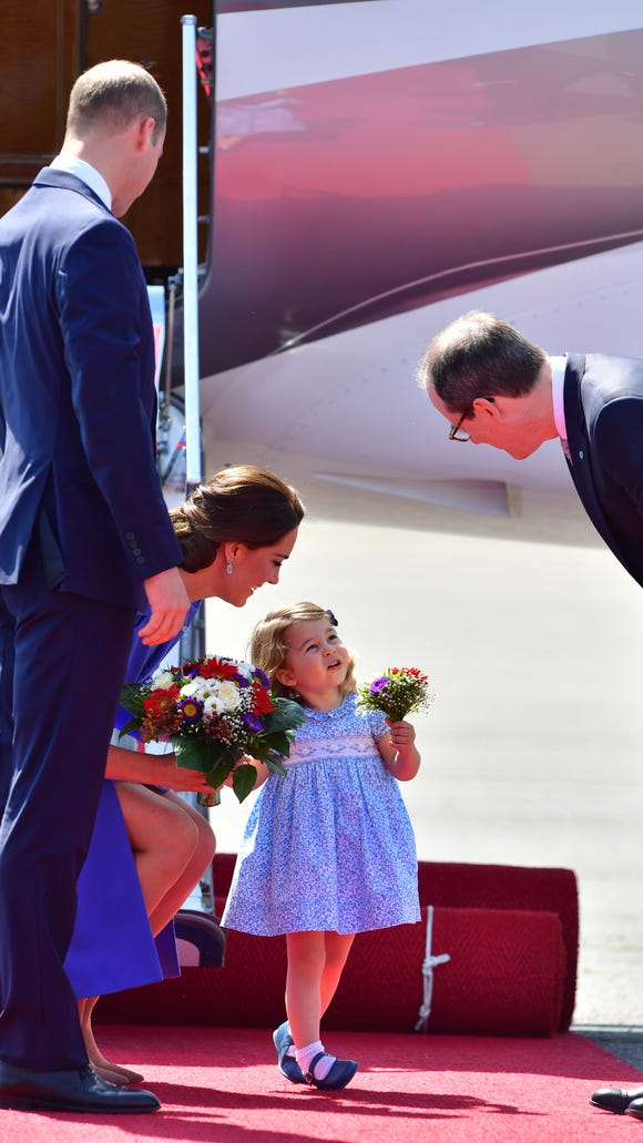 Charlotte holding a mini bouquet of flowers = cutest.
