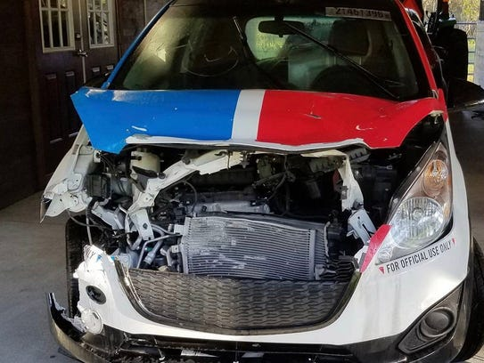 The wrecked Domino's Pizza delivery car bought by Samcrac.