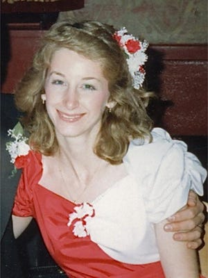 This undated photo provided by the Griffin family shows Julie Jensen, whose body was found in 1998 in the Pleasant Prairie, Wis., home she shared with her husband Mark and their two sons. A judge set a $1.2 million bond Wednesday, Jan. 6, 2016, for Mark Jensen, a Wisconsin man once convicted in his wife's death after prosecutors said he poisoned her with antifreeze in an effort to make her death look like a suicide. Jensen was found guilty and sentenced to life in prison in 2008, but he recently won appeals that set up a retrial in Kenosha County. (Griffin Family via AP)