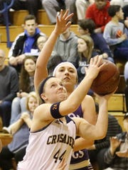 Elmira Notre Dame's Mackenzie Maloney goes up for a shot as Taylre Perkins of Union Springs defends during a Section 4 Class C first-round game at Notre Dame in February.