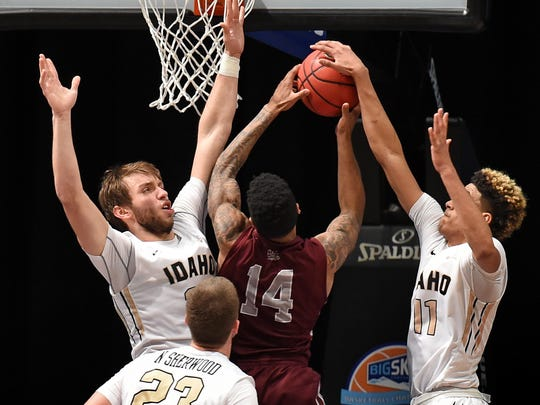 Idaho's Victor Sanders #11 blocks a shot by Montana's