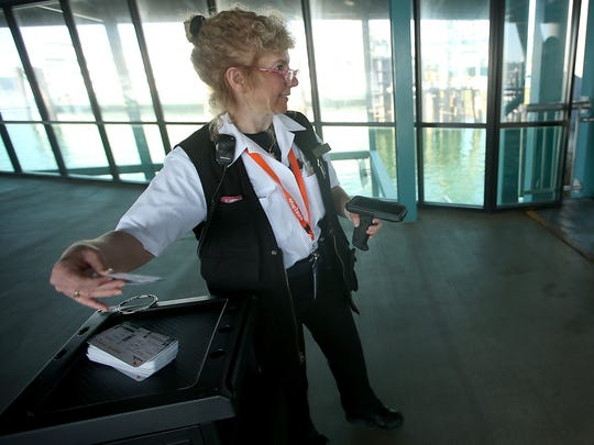 Kitsap Transit's Marie Pavlovich gets boarding passes ready for passengers on Wednesday.