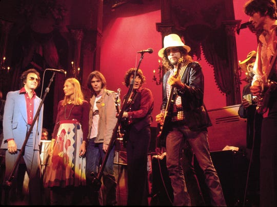 Classic rockers Neil Diamond, Joni Mitchell, Neil Young, Rick Danko, Bob Dylan and Robbie Robertson jam during The Band's final concert in 1978, captured in the motion picture, 'The Last Waltz.'