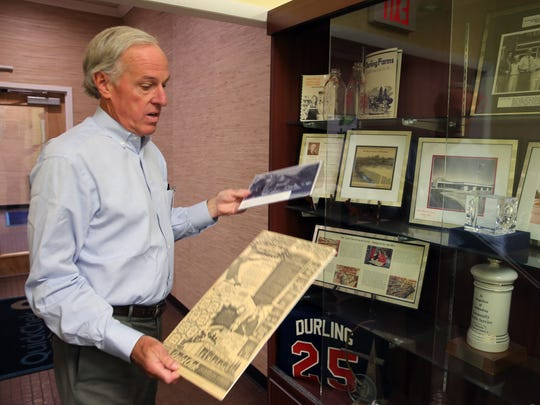 Dean Durling, the president of Quick Chek is photographed in his office at Quick Chek headquarters in Readington on Wednesday July 20, 2016. Here Durling shows some of the Quick Chek memorabilia that is on display at the company's headquarters.