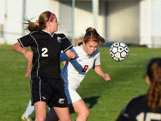 Riverheads' Bess Wood heads the ball before Buffalo