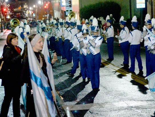 The marching band for Robert E. Lee High School warms