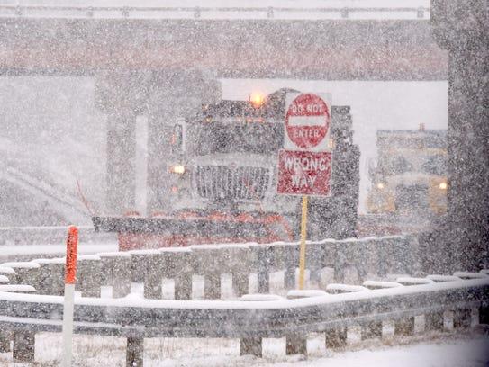 Snow falls as a Virginia Department of Transportation