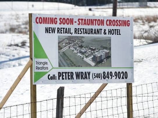 "A sign advertises ""new retail, restaurant and hotel"""