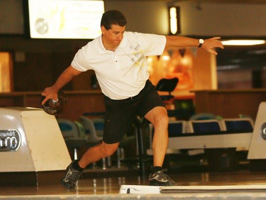 Russ Myers rolls a ball during a Saturday league at