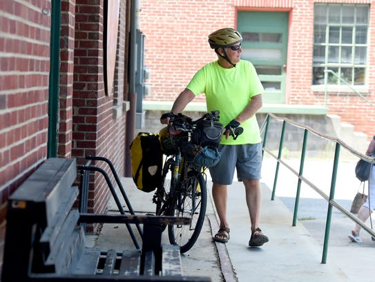 Bicyclist T.J. Forrester prepares to depart Black Dog