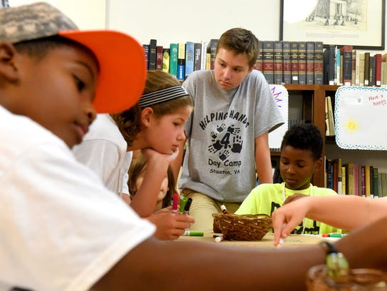 Walter Pultz, 13, works as a camp counselor at Helping