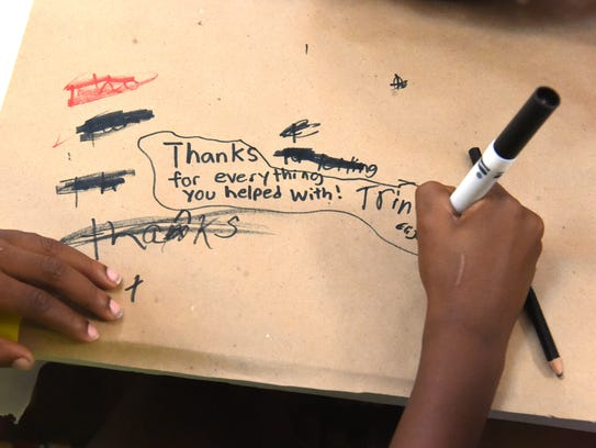 Camp participant Elijah Marks, 9, adds a personal message