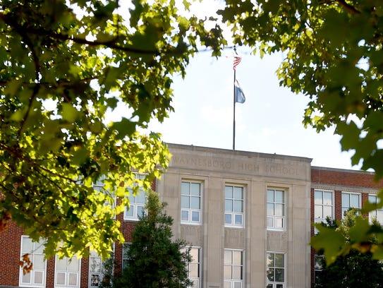Flags flutter in the breeze over Waynesboro High School