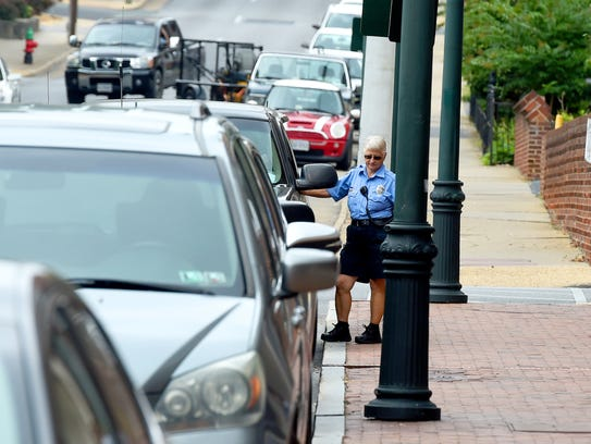 Parking enforcement officer Mary Fitzgerald takes a