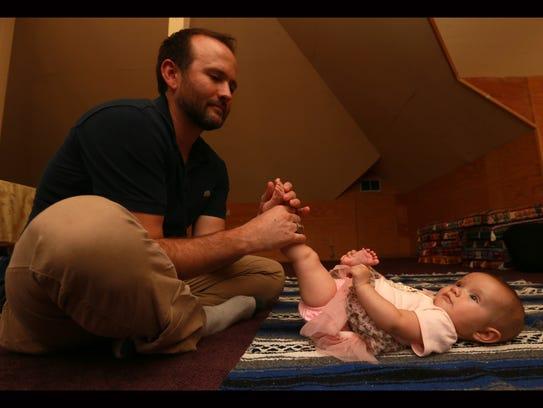 Joshua Graber massages daughter Madison Graber's foot