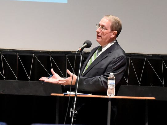U.S. Rep. Bob Goodlatte looks to and speaks about his