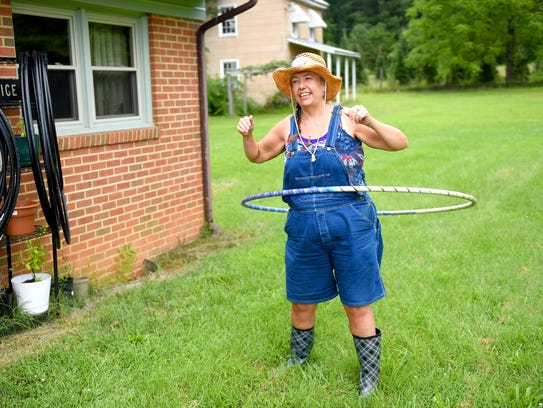 Linda Tabor has found hola hooping and performing tricks