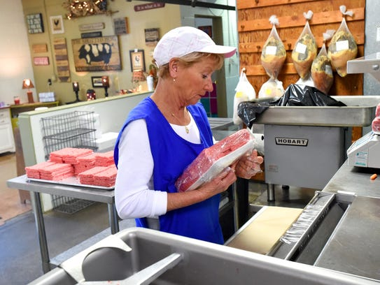 Owner Terri Breeden uses the meat wrapper to package