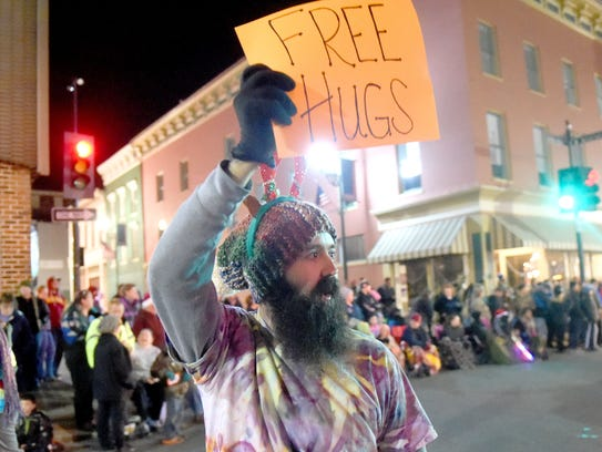 Free hugs are offered during the Staunton Christmas