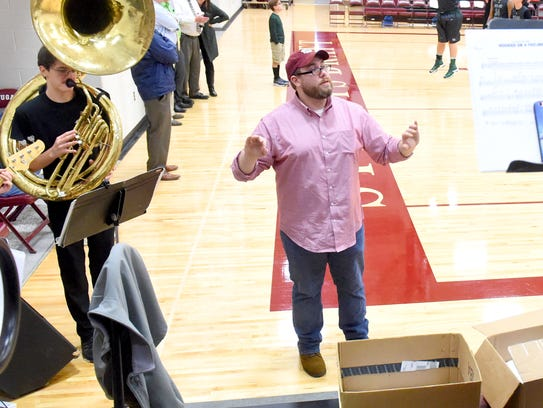 Band director Andrew Fauber leads Stuarts Draft's pep