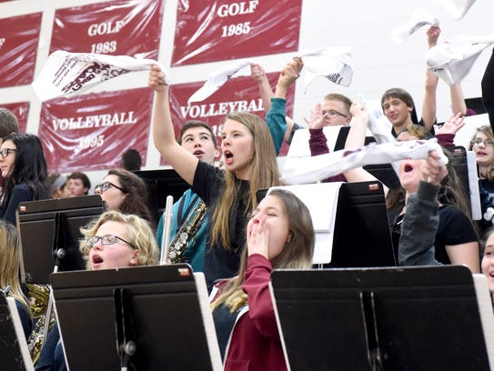 Members of the Stuarts Draft High School pep band cheer