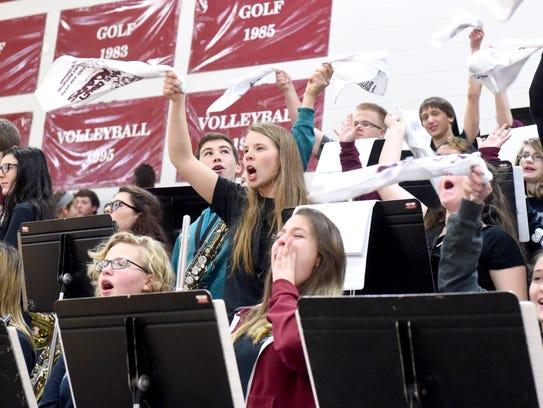 Members of the Stuarts Draft High School pep band cheer