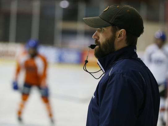 Coach Tom Herman watches the UTEP hockey team go through