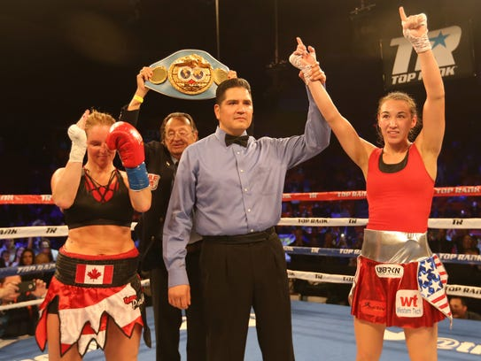 Referee Roberto Velez raised Jennifer Han's hand in