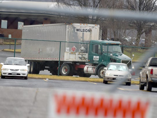 A tractor-trailer departs from Wilson Trucking's terminal