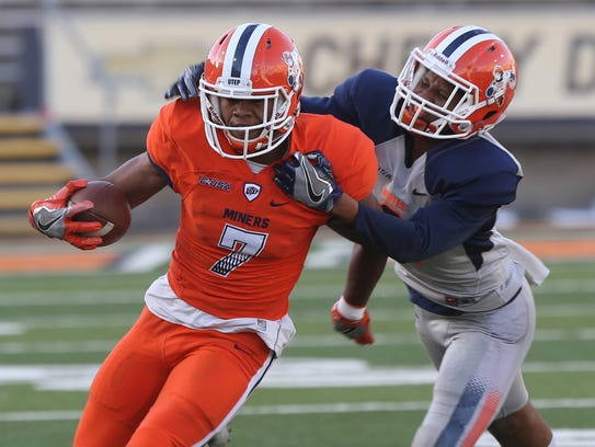 UTEP receiver Kavika Johnson tries to shake a tackle