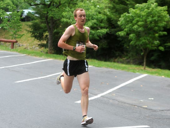 Matthew Denlinger won Tuesday's Firecracker 5K with