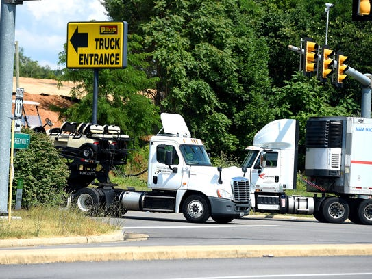 Tractor-trailers come and go from a truck stop in Greenville