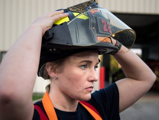 Peytonsville volunteer firefighter Tara Stouder puts