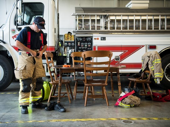 Peytonsville volunteer firefighter Dalton Piercey suits