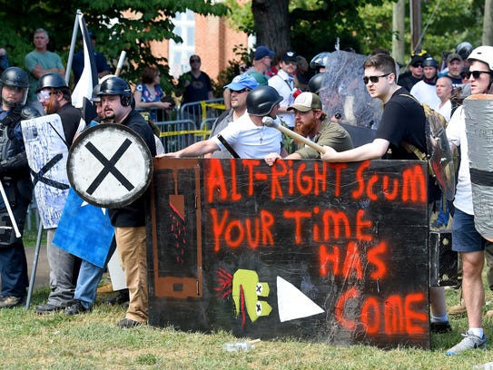 White protesters taunt counter protesters after having
